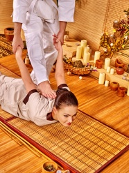 Woman getting bamboo massage